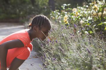 Schoolgirl smelling lavendar