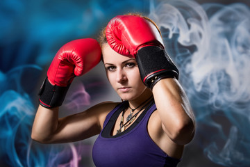 Portrait of beautiful girl with red boxing gloves