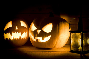 Halloween pumpkins with a lantern on wooden background