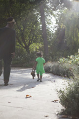 Toddler with dark skin walking