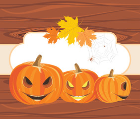 Halloween pumpkins on the wooden background with frame