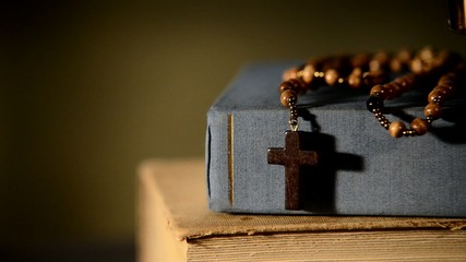 bible with books and rosary, zoom in