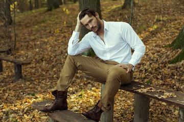 Fashion model posing in autumn scenery