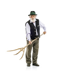 Old man with pitchfork isolated