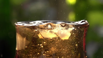 Whirling Ice Cubes in a Glass