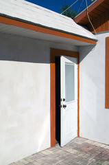 open white door with orange trim