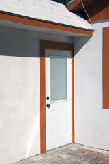 closed white door with orange trim