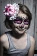 kleines Mädchen mit Sugar Skull Make up