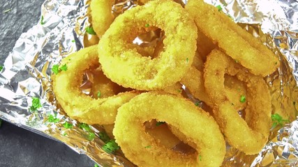 Portion of Onion Rings as seamless loopable 4K footage