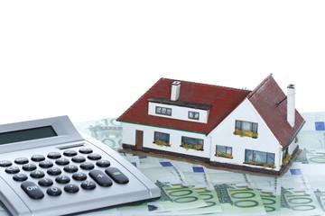 Geldrechnung mit Haus