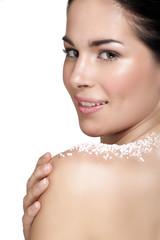 Beautiful young woman applying scrub treatment on the skin