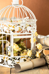 Wedding invitation next to decorative cage