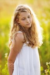 Beautiful girl in a dress of wildflowers