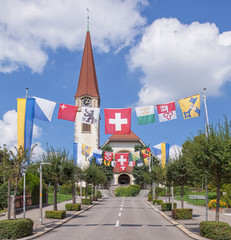 Street, decorated with flags for the Swiss Nationa
