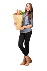 Young girl holding a grocery bag