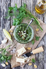 Delicious homemade pesto of green herbs with pumpkin seeds