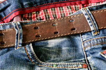 Textile: blue jeans with a brown leather