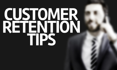 Business man with the text Customer Retention Tips