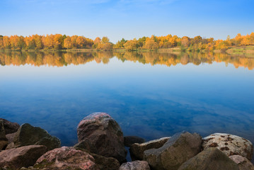 Autumn landscape, trees reflection in lake
