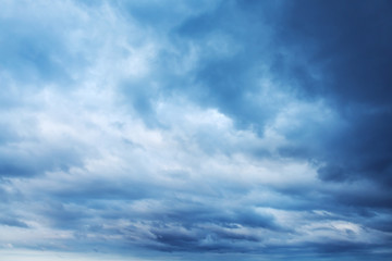 Dark blue sky with clouds, abstract background