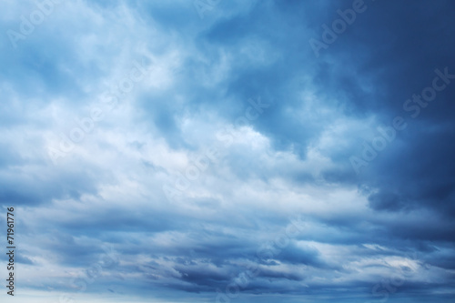 Dark blue sky with clouds, abstract background - 71961776