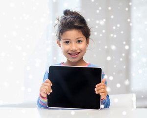 smiling girl with tablet pc at home
