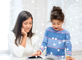 mother and daughter with book indoors