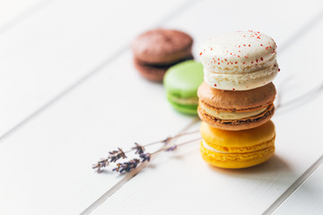 Macarons stack on white wooden background