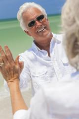 Happy Senior Man Woman Couple Dancing on Beach