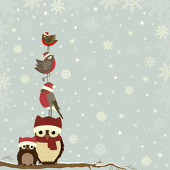 Christmas card a branch with owls and bird