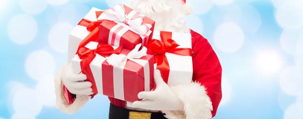 close up of santa claus with gift box