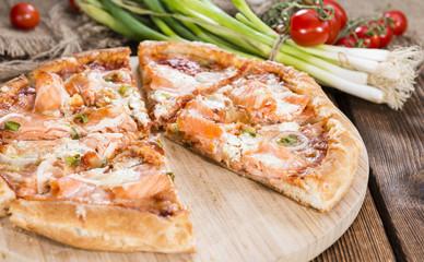 Salon Pizza on wooden background