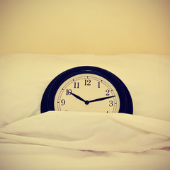 clock in bed, with a retro effect