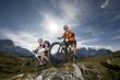 Woman and man in the mountain biking