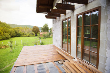 Unfinished wooden flooring in patio