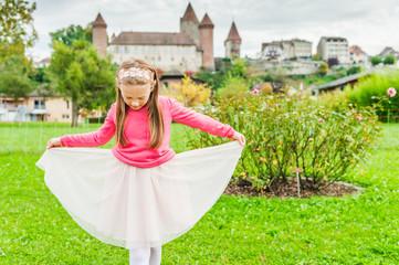 Cute little girl playing in a nice garden