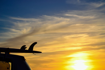 surfboard fins at sunset