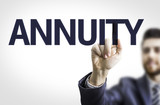 Business man pointing to transparent board with text: Annuity poster