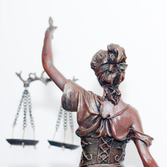 lady justice or themis goddess standing back