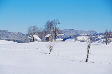 Chapel in winter landscape