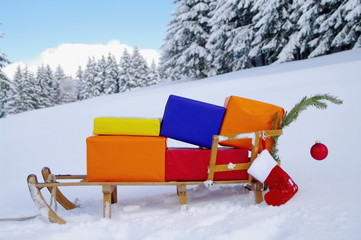 Sledge with Christmas presents in winter landscape