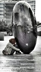 Girl at the black oval stone