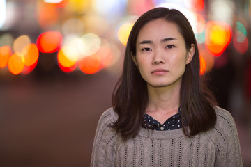 Young Asian Woman sad face portrait at night