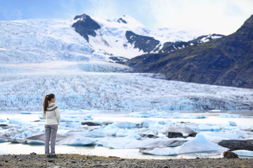 Adventure woman by glacier nature on Iceland
