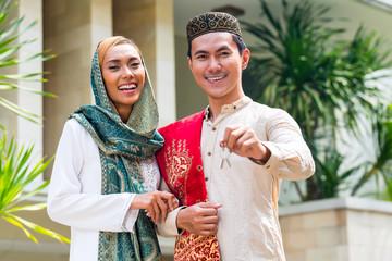 Asian Muslim couple wearing traditional dress