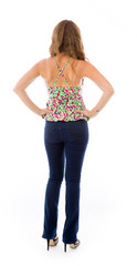 model isolated on plain background back hands on hips