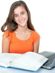 Hispanic teenage girl studying isolated on white