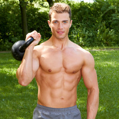Gorgeous Topless Fit Man Carrying Weights Outdoor