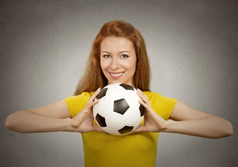 happy football girl in yellow t-shirt on grey background