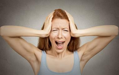 headshot stressed woman screaming isolated on grey background